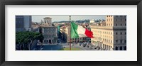 Framed Italian flag fluttering with city in the background, Piazza Venezia, Vittorio Emmanuel II Monument, Rome, Italy