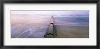 Framed Tide break on the beach at sunrise, Cape Hatteras National Seashore, North Carolina, USA
