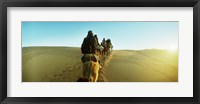 Framed Row of people riding camels through the desert, Sahara Desert, Morocco