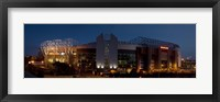 Framed Football stadium lit up at night, Old Trafford, Greater Manchester, England