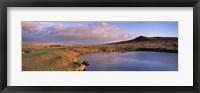 Framed Pond and warm evening light at Sharpitor, Dartmoor, Devon, England