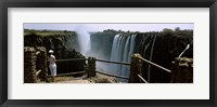 Framed Woman looking at the Victoria Falls from a viewing point, Zambia