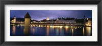 Framed Buildings lit up at dusk, Chapel Bridge, Reuss River, Lucerne, Switzerland