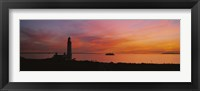 Framed Silhouette of a lighthouse at sunset, Scotland