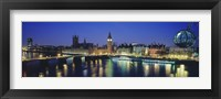 Framed Buildings lit up at dusk, Big Ben, Houses Of Parliament, Thames River, London, England