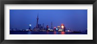 Framed Buildings at the waterfront lit up at dusk, Pudong, Shanghai, China