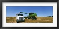 Framed Combine in a wheat field, Kearney County, Nebraska, USA