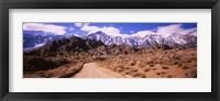 Framed Dirt road passing through an arid landscape, Lone Pine, Californian Sierra Nevada, California, USA