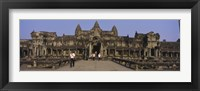 Framed Tourists walking in front of an old temple, Angkor Wat, Siem Reap, Cambodia