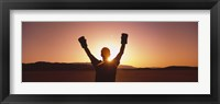 Framed Silhouette of a person wearing boxing gloves in a desert at dusk, Black Rock Desert, Nevada, USA