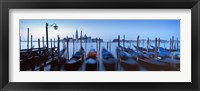 Framed Row of gondolas moored near a jetty, Venice, Italy