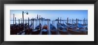 Framed Row of gondolas moored near a jetty, Venice, Italy