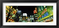 Framed Low angle view of buildings lit up at night, Shinjuku Ward, Tokyo Prefecture, Kanto Region, Japan