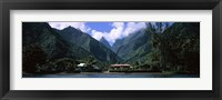 Framed Mountains and buildings on the coast, Tahiti, French Polynesia