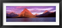 Framed Lake with mountains at dusk, Swiftcurrent Lake, Many Glacier, US Glacier National Park, Montana, USA
