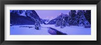 Framed Lake in winter with mountains in the background, Lake Louise, Banff National Park, Alberta, Canada