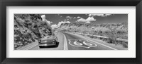 Framed Vintage car moving on Route 66 in black and white, Arizona