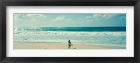Framed Surfer standing on the beach, North Shore, Oahu, Hawaii