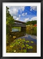 Framed Covered bridge across a river, Vermont, USA