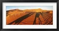Framed Shadows of camel riders in the desert at sunset, Sahara Desert, Morocco
