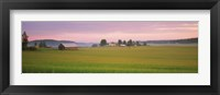 Framed Barn and wheat field across farmlands at dawn, Finland