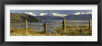 Framed Fence in front of a lake with mountains in the background, Lake General Carrera, Andes, Patagonia, Chile