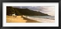 Framed People walking along the Beau Vallon beach, Mahe Island, Seychelles