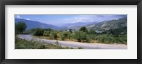 Framed Road passing through a landscape with mountains in the background, Andalucian Sierra Nevada, Andalusia, Spain