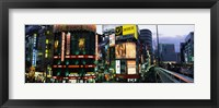 Framed Buildings in a city lit up at night, Shinjuku Ward, Tokyo Prefecture, Kanto Region, Japan