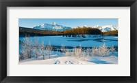 Framed Frozen river with mountain range in the background, Mt Fryatt, Athabaska River, Jasper National Park, Alberta, Canada