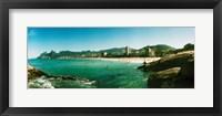 Framed Tourists on the beach, Ipanema Beach, Rio de Janeiro, Brazil