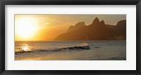 Framed Surfers at sunset on Ipanema Beach, Rio De Janeiro, Brazil