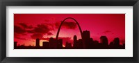 Framed Gateway Arch with city skyline at sunset, St. Louis, Missouri