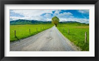 Framed Country gravel road passing through a field, Hyatt Lane, Cades Cove, Great Smoky Mountains National Park, Tennessee