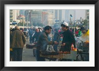 Framed Muslim Chinese Uyghur minority food vendors selling food in a street market, Pudong, Shanghai, China