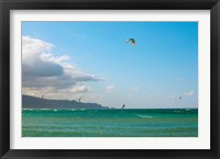 Framed Tourists kiteboarding in the ocean, Maui, Hawaii, USA