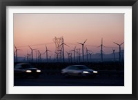 Framed Cars moving on road with wind turbines in background at dusk, Palm Springs, Riverside County, California, USA