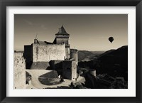 Framed Chateau de Castelnaud with hot air balloon flying over a valley, Castelnaud-la-Chapelle, Dordogne, Aquitaine, France