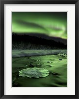 Framed Aurora Borealis reflects off the Tennevik River, Troms County, Norway