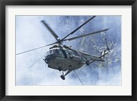 Framed Bulgarian Air Force Mi-17 helicopter over a forest fire in Bulgaria