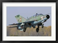 Framed Bulgarian Air Force MiG-21UM jet fighter taking off