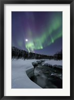Framed Aurora Borealis over the Blafjellelva River in Troms County, Norway