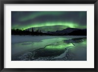 Framed Reflected aurora over a frozen Laksa Lake, Nordland, Norway