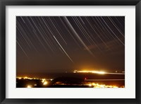 Framed Star trails above a village in the central desert of Iran
