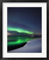 Framed Aurora Borealis over Vagsfjorden in Troms County, Norway
