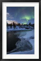 Framed Aurora Borealis over Tennevik River, Troms, Norway