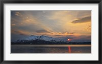 Framed Midnight Sun over Tjeldsundet strait in Troms County, Norway