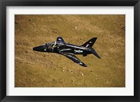 Framed Hawk T1 trainer aircraft of the Royal Air Force flying over barren terrain North Wales
