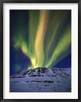 Framed Aurora Borealis over Toviktinden Mountain in Troms County, Norway