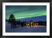 Framed Aurora Borealis over farm houses, Tennevik Lake, Troms, Norway